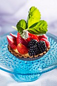 A strawberry and blackberry tartlet
