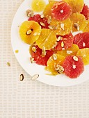 Orange salad with honey, almonds and walnuts (seen from above)