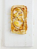 Puff pastry tart with pears, cheese and honey (seen from above)