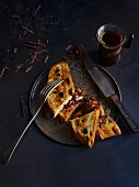 Toasted Christmas cake with oranges, chocolate and star anise