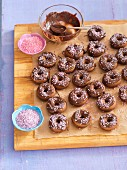 Mini chocolate doughnuts with pink sugar