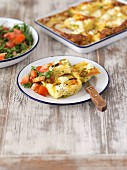 Oven-roasted potato omelette with feta cheese and a tomato and rocket salad