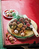 Shelled and unshelled lychees on a wooden board