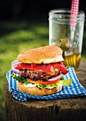 A jalapeño burger with grilled peppers, tomatoes and lettuce