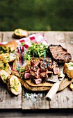 Grilled, marinated beef steaks with garlic bread