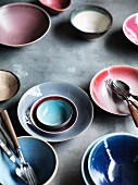 Various ceramic bowls and cutlery