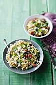 Pasta salad with ricotta, peas, bacon and lemons