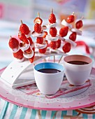 Strawberry and marshmallow skewers with a chocolate dip
