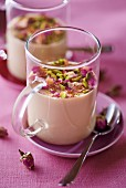 Chai tea panna cotta with rose buds and pistachios