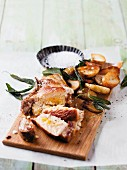 Pork chops with an apricot and almond filling and crispy sage potatoes