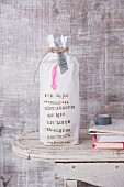 Spiced oil packed as a message in a bottle as a gift