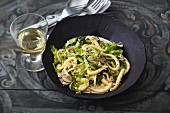 Creamy Spätzle (soft egg noodles from Swabia) with savoy cabbage and mushrooms