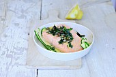 Poached salmon fillet with herbs and capers