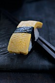 Tamago sushi with omelette and nori