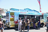 Customers in front of a Thai food truck at a food truck festival in California, USA