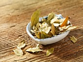 A bowl of dried curry leaves