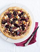 A beetroot, goat's cheese and caper pizza