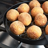 Vegan tofu balls being fried