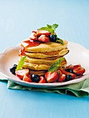Pancakes with golden syrup and berries