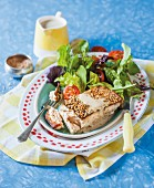 Yellow-tail mackerel with a sesame seed crust with a green Thai curry sauce and a salad