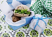 Wheat rolls with lettuce and cheese in a lunchbox