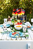 Table set for football-themed party in summery garden