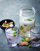 White wine sangria with white peaches and mint