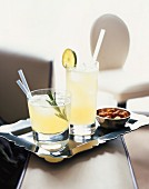 Two cocktails: Sunday Roast and Ginger Sling