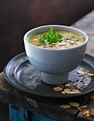 Cream of vegetables soup with roasted flaked almonds