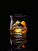 Whiskey on the rocks with orange zest