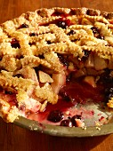 Apple and berry pie, sliced (close-up)