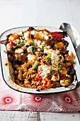 Vegetarian pasta bake with vegetables and ricotta