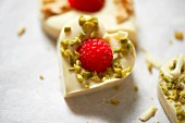 White chocolate heats with pistachios and raspberries
