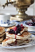 Blinis (honey-yeast pancakes, Russia) cherry compote and a samowar