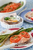 Arctic char with tomatoes and asparagus