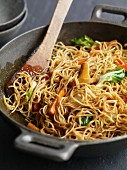 Fried noodles and vegetables in a wok