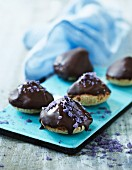 Almond macaroons with chocolate glaze and candied lavender
