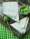 Filo pastry pockets with spinach and feta cream being made