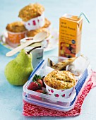 Carrot and lemon muffins with pears in a lunch box
