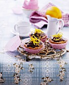 Cupcakes with chocolate cream and orange zest