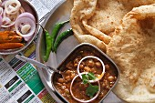 Chole bhature (deep fried bread with a spicy chickpea sauce, India)