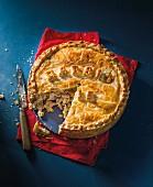 Sliced rabbit pie with mushrooms and leek