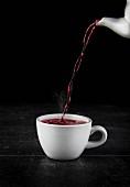 Raspberry tea being poured