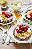 Chocolate tartlets with ricotta, cherries and pistachio nuts