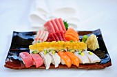 A mixed sushi platter with nigiri, maki and sashimi