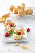 Profiteroles with cream, raspberries and mint
