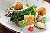Asparagus with fish balls and potatoes