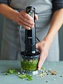 Tom Ka Gai (Thai chicken soup) being made: herbs being chopped