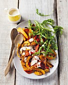 Butternut squash and pepper salad with a yoghurt dressing and rocket
