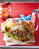 A pulled pork sandwich with cola